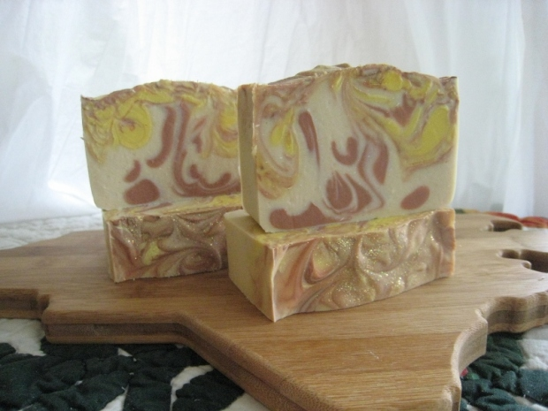 Sweet Tea Silk Soap - yellow and chocolate coloured mica swirls on white background.
